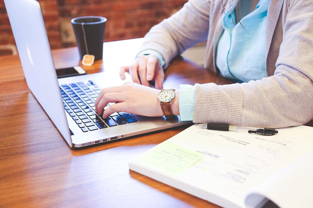 woman laptop working tea cup